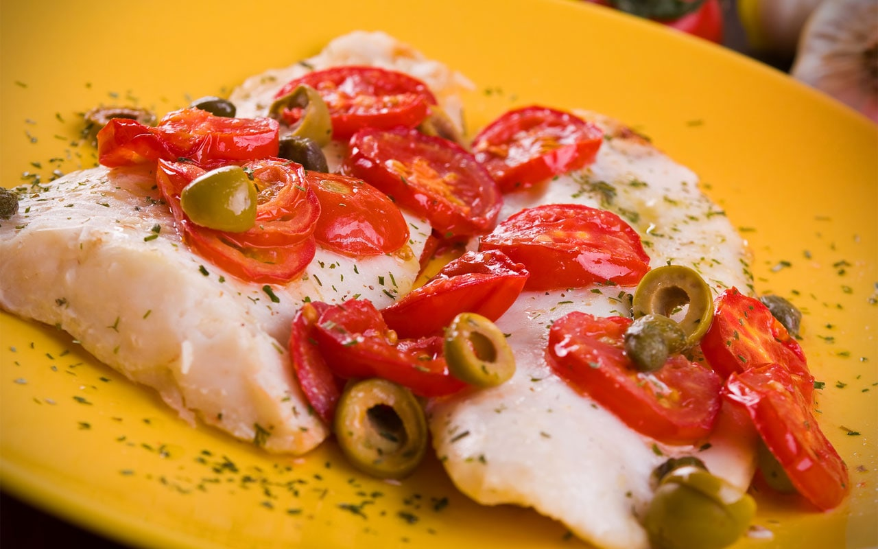 Cod with cherry tomatoes and Taggiasca olives