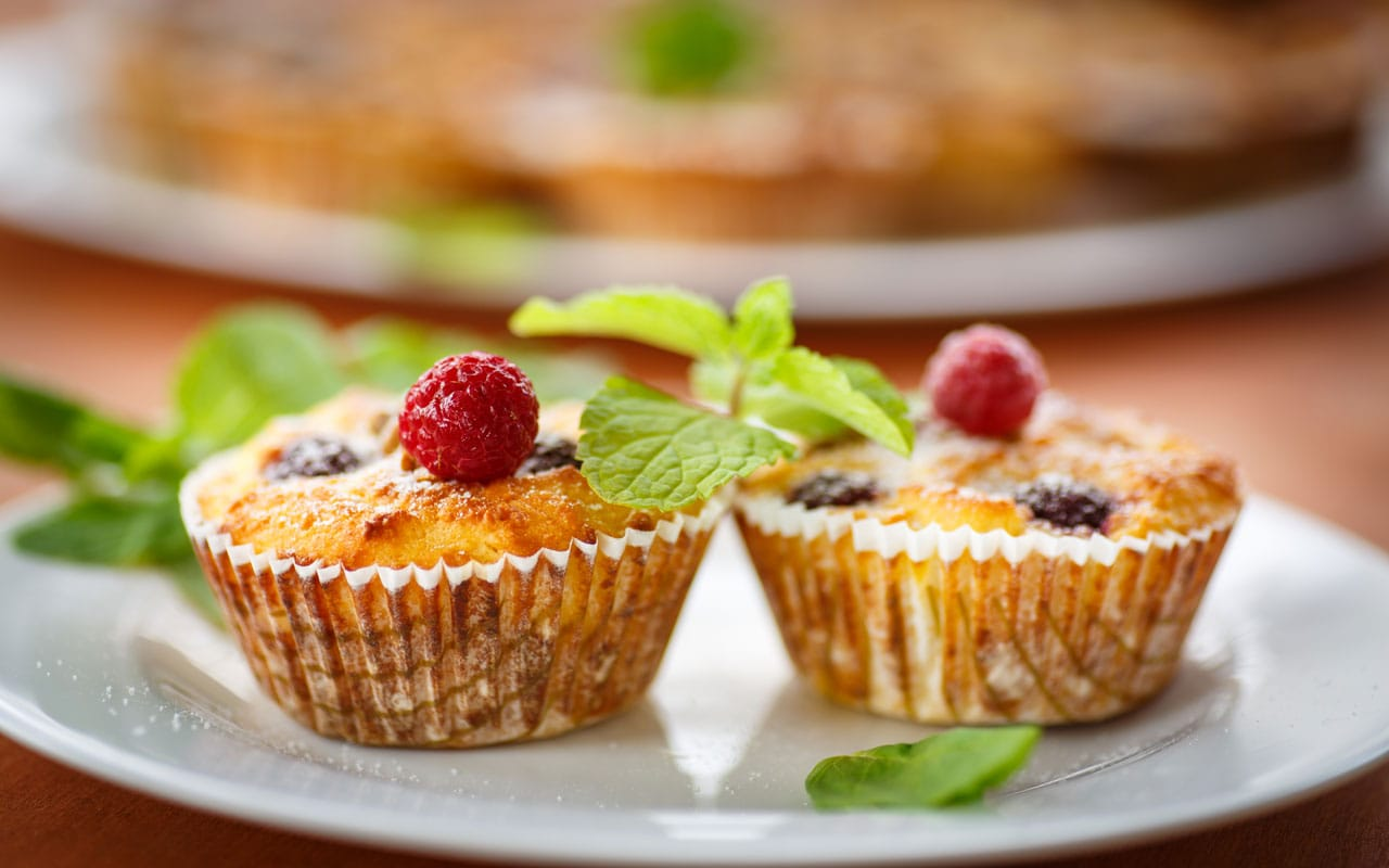 Ricotta muffins with berries and pine nuts.