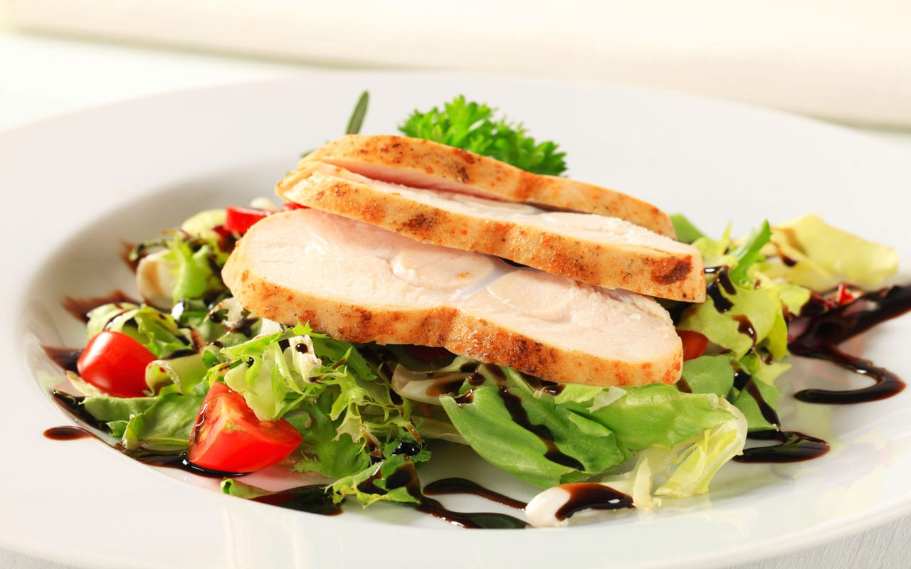 Green salad with baked chicken breast