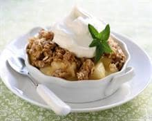 Baked apples with whipped cream and nuts